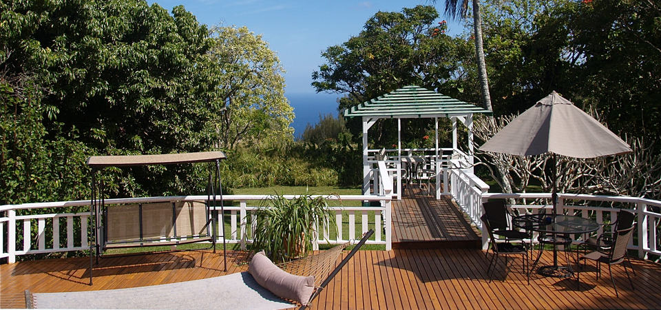 Waipio Wayside, Sun deck, gazebo, hammock, covered swing bench, umbrella table with chairs