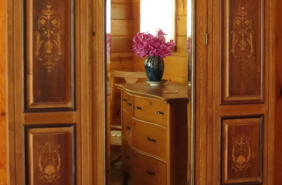 Waipio Wayside, Birds Eye Room, wood dresser flanked by ornate wooden panels