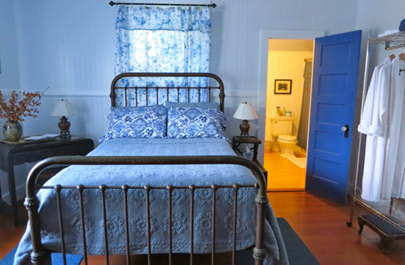 Waipio Wayside, Chinese Room, blue quilt bed with bathroom in background