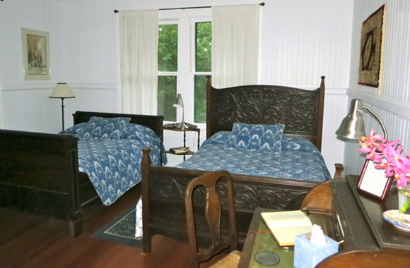 Waipio Wayside, Plantation Room, two bed and a table